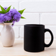 Black coffee mug mockup with blue Ageratum in pitcher - PhotoDune Item for Sale