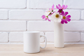 White coffee mug mockup with white and pink daisy - PhotoDune Item for Sale