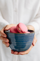 Woman Holding Bowl of Pink Macarons  - PhotoDune Item for Sale