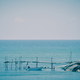 Toned image of calm sea, pontoon and fishing boats - PhotoDune Item for Sale
