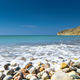 Idyllic calm tropical beach with turquoise sea water and pebble stones - PhotoDune Item for Sale