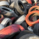 Variety of red white and black waste car tires piled in a big pile - PhotoDune Item for Sale