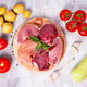 Selection of different raw meat with vegetables at wooden board .Lean proteins. - PhotoDune Item for Sale