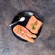 Salmon steaks on ice with salt on black plate. Lean proteins. - PhotoDune Item for Sale