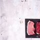 Different types of meat on dark slate cutting board. Lean proteins. - PhotoDune Item for Sale