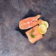 Raw salmon fillet with rosemary on stone cutting board. Lean proteins. - PhotoDune Item for Sale