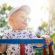 Baby boy playing in playground having fun - PhotoDune Item for Sale