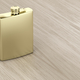 Golden hip flask on wooden table - PhotoDune Item for Sale