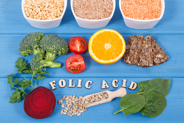 Inscription folic acid with nutritious different ingredients containing vitamin B9 and minerals - Stock Photo - Images