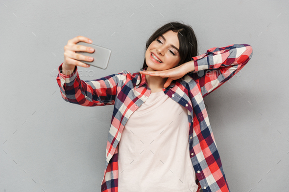 Cute beautiful young lady make selfie by mobile phone. - Stock Photo - Images
