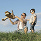 Father and Son Playing with Cardboard Toy Airplane - VideoHive Item for Sale