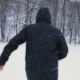 Man in Black Hood and Stylish Boots Running in Snowy Central Park, Snowfall - VideoHive Item for Sale