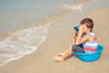 One happy little boy playing on the beach at the day time. - PhotoDune Item for Sale