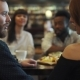 Company of Friends at a Table in a Cafe. the Guy Is Talking To His Girlfriend - VideoHive Item for Sale