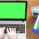 Man Hands Typing on a Laptop with Green Screen Then Touching a Green Screen Display on a Smartphone - VideoHive Item for Sale