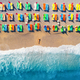 Aerial view of lying woman on the beach with colorful chaise-lounges - PhotoDune Item for Sale