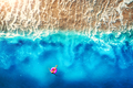 Aerial view of woman swimming on the pink swim ring in the sea - PhotoDune Item for Sale