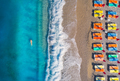 Aerial view of swimming woman in the sea and sandy beach - PhotoDune Item for Sale