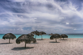 Beach umbrellas made of palm branches on the shores of the Caribbean Sea