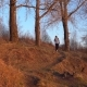 The Tourist Descends From the Hill with a Backpack at Sunset - VideoHive Item for Sale