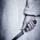 Killer woman with a knife. Violence aggression. Criminal murderer. Assassin - PhotoDune Item for Sale