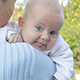 Mother is holding a baby in his arms. - VideoHive Item for Sale