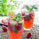 Homemade iced tea with strawberries and mint on wooden table, ve - PhotoDune Item for Sale