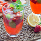 Homemade iced tea with strawberries and mint on a wooden table, - PhotoDune Item for Sale