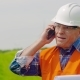 Engineer Talking On Mobile Phone While Walking In Farm - VideoHive Item for Sale
