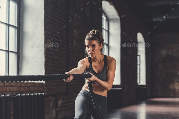 Young girl with a rope on a sports training - Stock Photo - Images