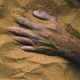 Hand of dead person buried in sand - PhotoDune Item for Sale
