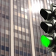 Green traffic lights on office building background, copy space. - PhotoDune Item for Sale