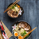 Two ramen bowls with pork, egg and chives, top view - PhotoDune Item for Sale