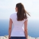Woman Stand at Edge of Cliff on Sunny Day in Carefree Female Look at View of Blue Sea - VideoHive Item for Sale