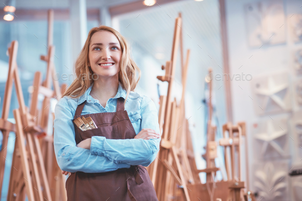Smiling artist at easels - Stock Photo - Images