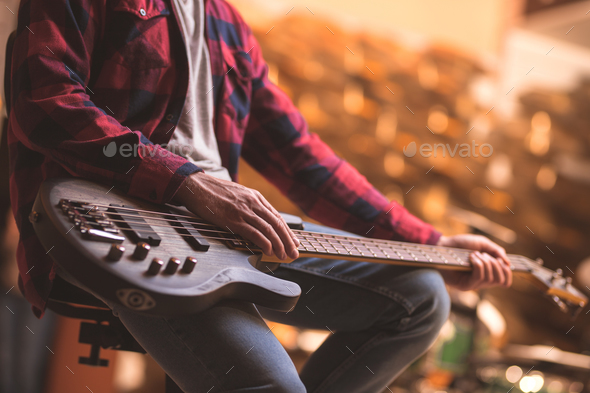 Man with a bass guitar - Stock Photo - Images