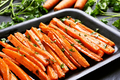Fried carrots with green herbs