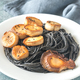 Portion of black pasta with king oyster scallops - PhotoDune Item for Sale