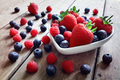 Strawberry, blueberry and raspberry fruit in a bowl - PhotoDune Item for Sale