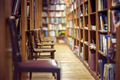 Library with books on shelf and empty chairs - PhotoDune Item for Sale