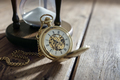 Gold pocket watch and hourglass - PhotoDune Item for Sale