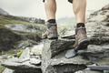 Hiking over rocks on a mountain trail - PhotoDune Item for Sale