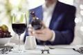 Businessman reading a wine bottle label in restaurant - PhotoDune Item for Sale
