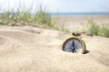 Compass on the beach with sand and sea - PhotoDune Item for Sale