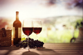 Red wine bottle and glass on table in vineyard Tuscany Italy - PhotoDune Item for Sale