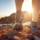 Runner feet running on trail looking at sunset - PhotoDune Item for Sale