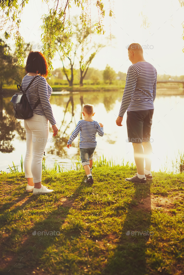 happy family in summer park - Stock Photo - Images