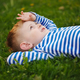 little boy lying on the grass - PhotoDune Item for Sale