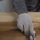 Man Wearing Protection Gloves Working with a Wood. - VideoHive Item for Sale
