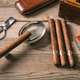 Cuban cigars on wooden background, top view - PhotoDune Item for Sale
